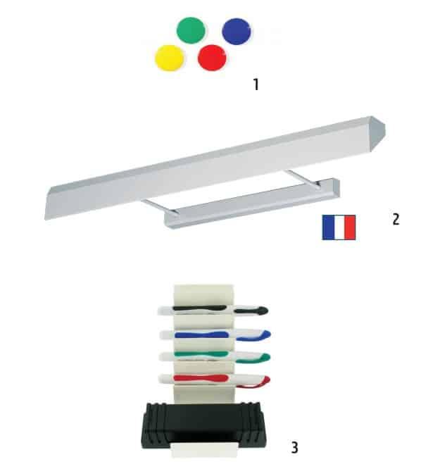 Divers éléments sur fond blanc, comme des aimants, une rampe d'éclairage, un porte outils comme des marqueurs, un tampon effaceur ou des craies